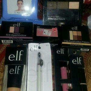 several Elf items and revlon makeup